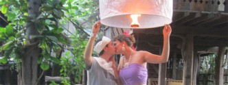 Kissing and making a wish with a sky lantern